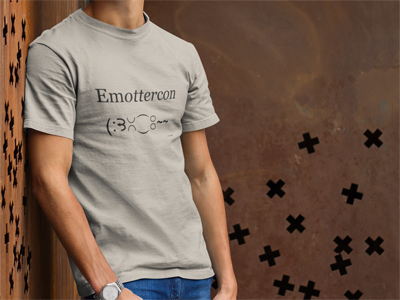 Young man wearing Otter Things EmOTTERcon soft cream t-shirt.