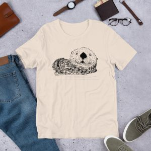 Sea-Otter-Pen-Ink-Unisex T-Shirt_mockup_Front_Flat-Lifestyle_Soft-Cream